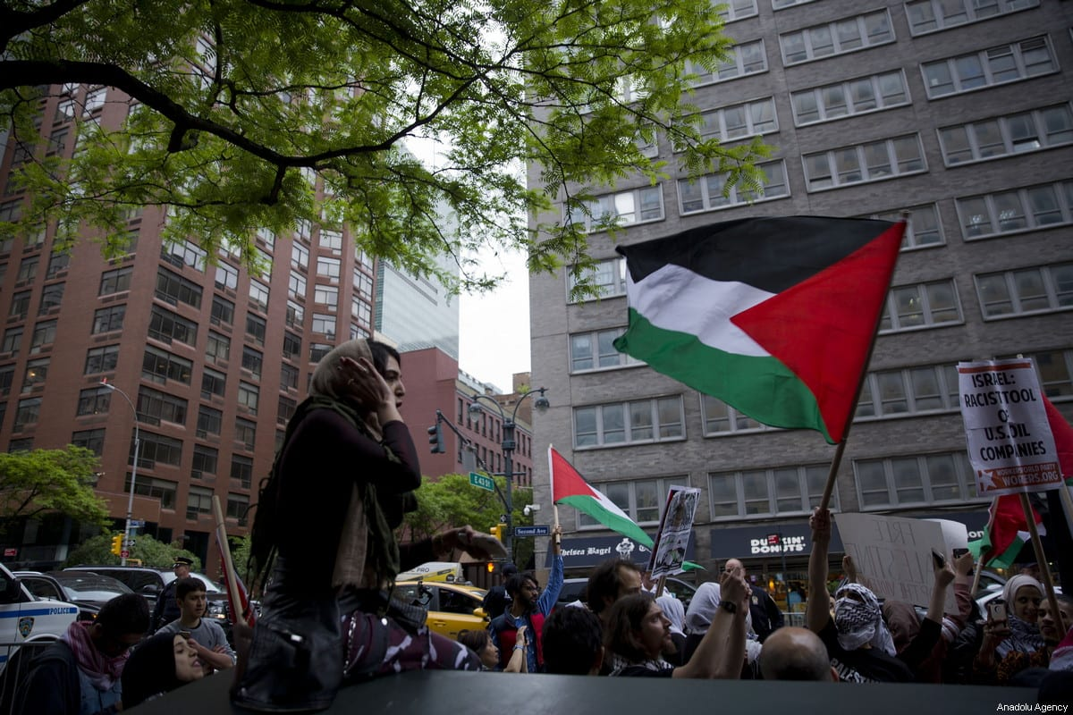 People march with banners and Palestinian flags during a demonstration, organized to mark the 70th anniversary of Nakba, also known as Day of the Catastrophe in 1948, and against the Israeli violence in Gaza on May 18, 2018 at Times Square in New York, United States [Mohammed Elshamy / Anadolu Agency]