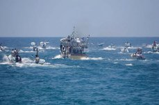 A ship carrying 20 Palestinians set out from the Port of Gaza in the hopes of breaking Israel's decade-long maritime embargo of the Gaza Strip [Mohammed Asad/Middle East Monitor]