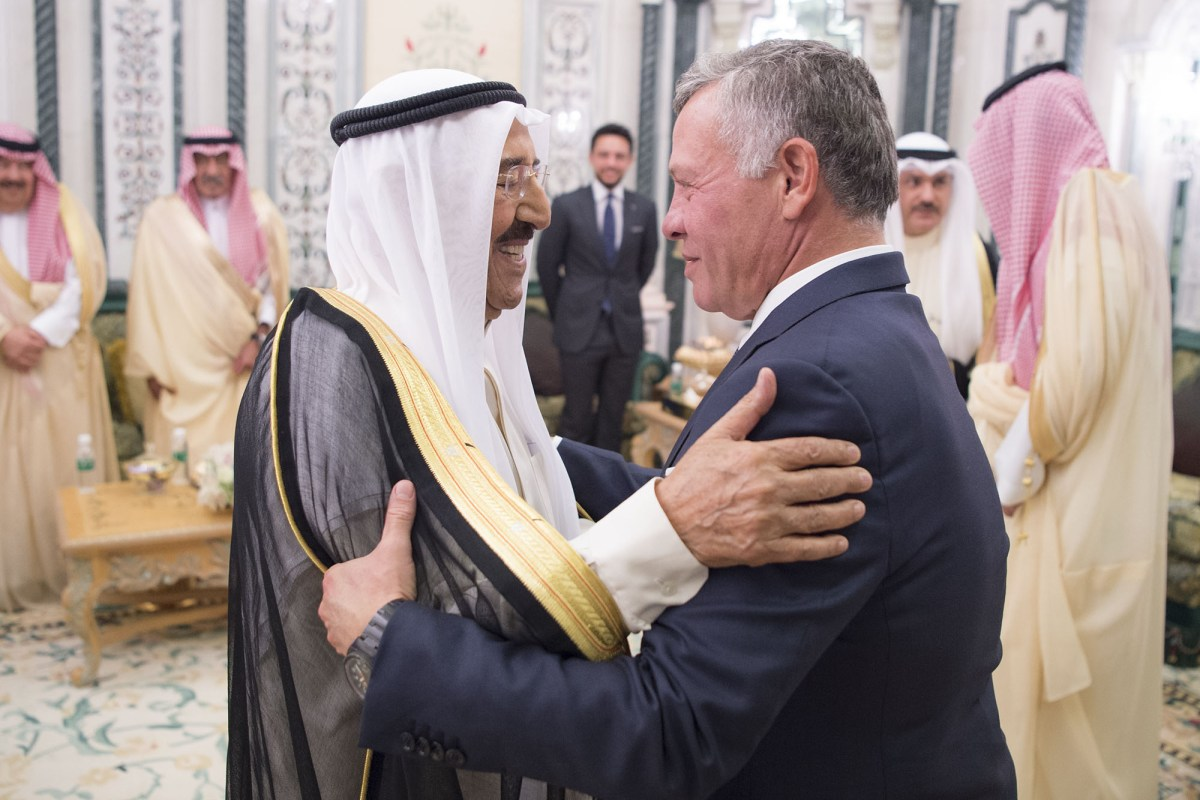 Jordanian King Abdullah II (R), Kuwaiti Emir Sheikh Sabah Al-Ahmad Al-Jaber Al-Sabah (L), King of Saudi Arabia, Salman bin Abdulaziz Al Saud (not seen) and Vice President of the United Arab Emirates (UAE), Sheikh Mohammed bin Rashid Al Maktoum (not seen) meet within a summit to discuss ways of easing an ongoing economic crisis in Jordan, on 11 June, 2018 in Mecca, Saudi Arabia [Saudi Kingdom Handout/Anadolu Agency]