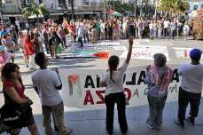 Crowds gather to greet the crew of the Freedom Flotilla ships as they prepare to leave Spain