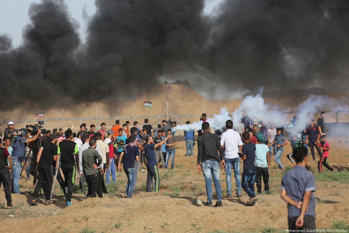 Israeli forces fire tear gas at protesters during the Great March of Return in Gaza on 23 June 2018 [Mohammed Asad/Middle East Monitor]