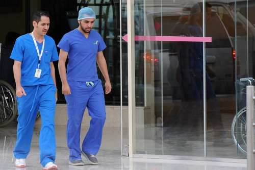 Saudi medical staff leave the emergency department at a hospital in the center of the Saudi capital Riyadh on April 8, 2014 [Fayez Nuredine / AFP]