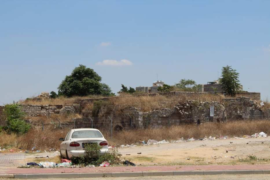 A car in is the ruins of the Hazana oil press
