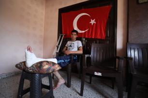 Palestinian Emin Selim (20) was shot by Israeli army as he was waving a Turkish flag during a protest within the 'Great March of Return' near Israel-Gaza border, at Shujaiyya neighbourhood of Gaza City, Gaza on 4 July, 2018 [Mustafa Hassona/Anadolu Agency]