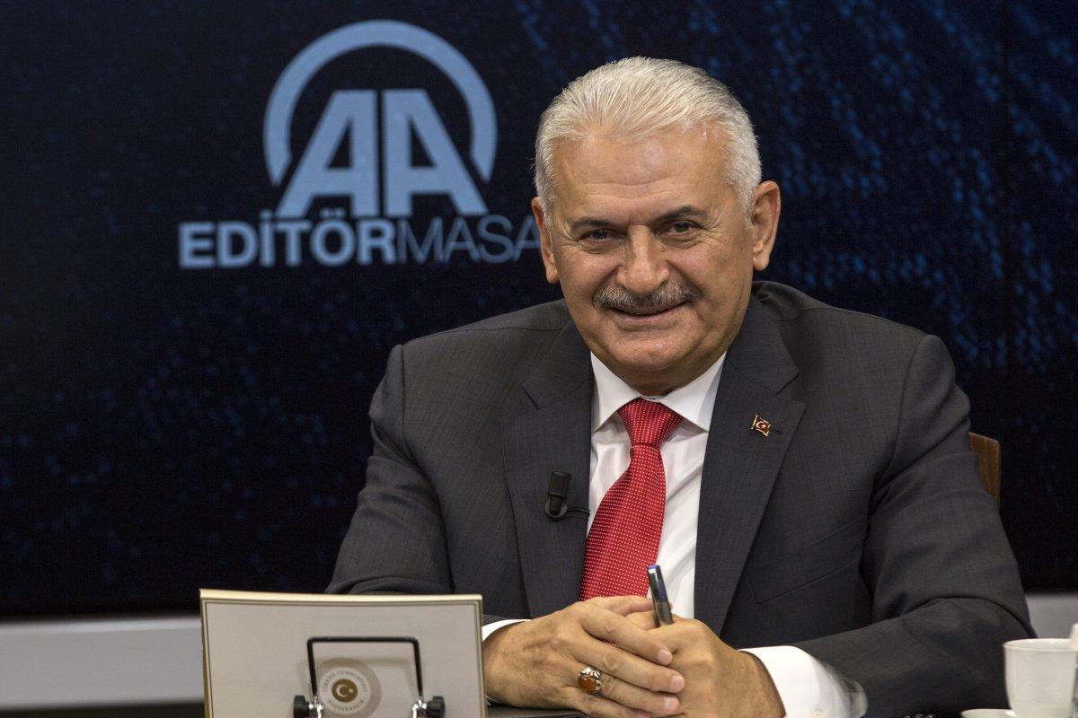 Turkish Prime Minister Binali Yildirim gestures as he is the special guest of Anadolu Agency's Editors' Desk in Ankara, Turkey on 5 July, 2018 [Ali Balıkçı/Anadolu Agency]