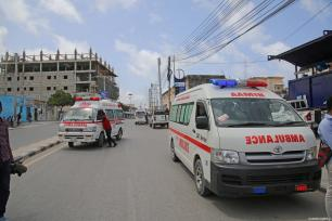 Ambulances arrive at the scene after a bomb laden car attack by al-Shabab militants in front of Interior Ministry in Mogadishu, Somalia on July 07, 2018 [Sadak Mohamed / Anadolu Agency]
