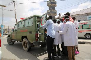 Health staff place an injured person in an ambulance after a bomb laden car attack by al-Shabab militants in front of Interior Ministry in Mogadishu, Somalia on July 07, 2018 [Sadak Mohamed / Anadolu Agency]