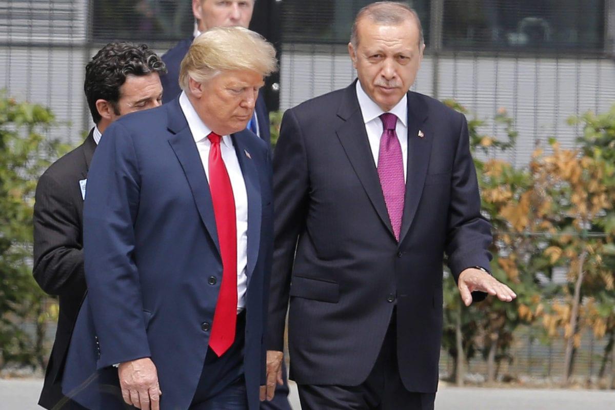 Turkish President Recep Tayyip Erdogan (R) talks to U.S. President Donald Trump (L) attends the 2018 NATO Summit at NATO headquarters on 11 July, 2018 in Brussels, Belgium [Murat Kaynak/Anadolu Agency]