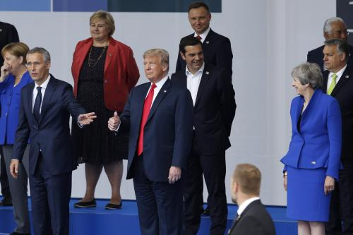 U.S. President Donald Trump (C), British Prime Minister Theresa May (R) and NATO Secretary General Jens Stoltenberg (L) attend the 2018 NATO Summit at NATO headquarters on 11 July, 2018 in Brussels, Belgium. [Murat Kaynak/Anadolu Agency]