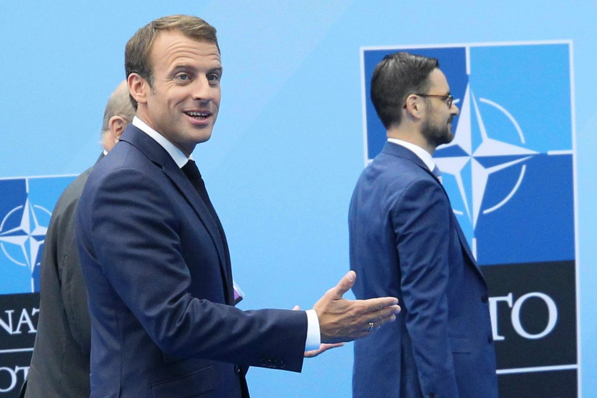 French President Emmanuel Macron (L) arrives on the second day of 2018 NATO (North Atlantic Treaty Organization) Summit at NATO headquarters on 12 July, 2018 in Brussels, Belgium [Dursun Aydemir/Anadolu Agency]