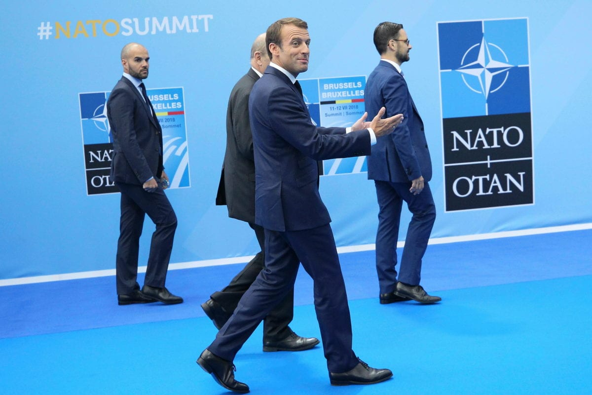 French President Emmanuel Macron (C) arrives on the second day of 2018 NATO (North Atlantic Treaty Organization) Summit at NATO headquarters on 12 July, 2018 in Brussels, Belgium [Dursun Aydemir/Anadolu Agency]