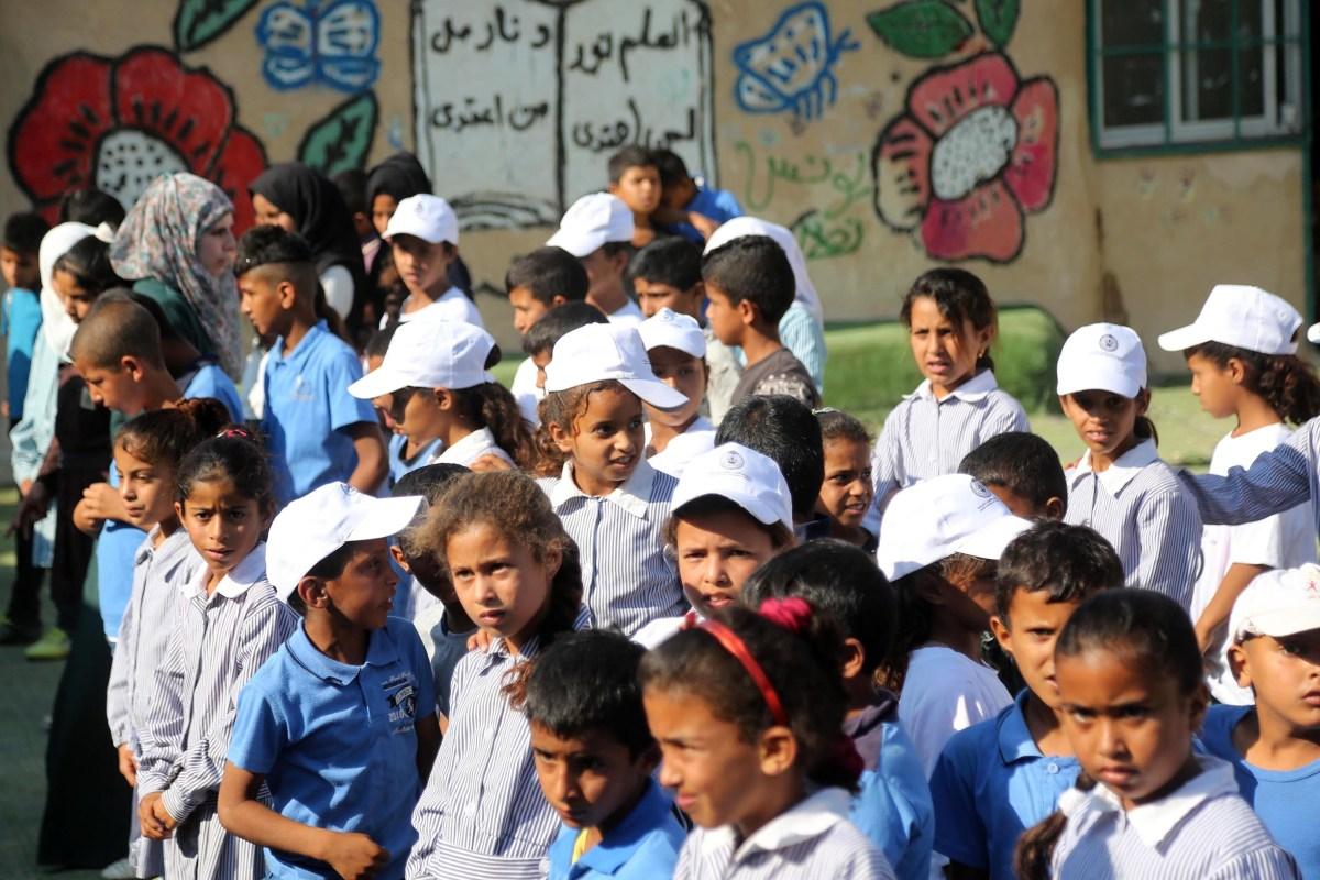 Palestinian Bedouin children wait in line before they enter classrooms at the only school in the region 'Itarat School' in Khan al-Ahmar region of Jerusalem on 16 July, 2018 [Ä°ssam Rimawi/Anadolu Agency]