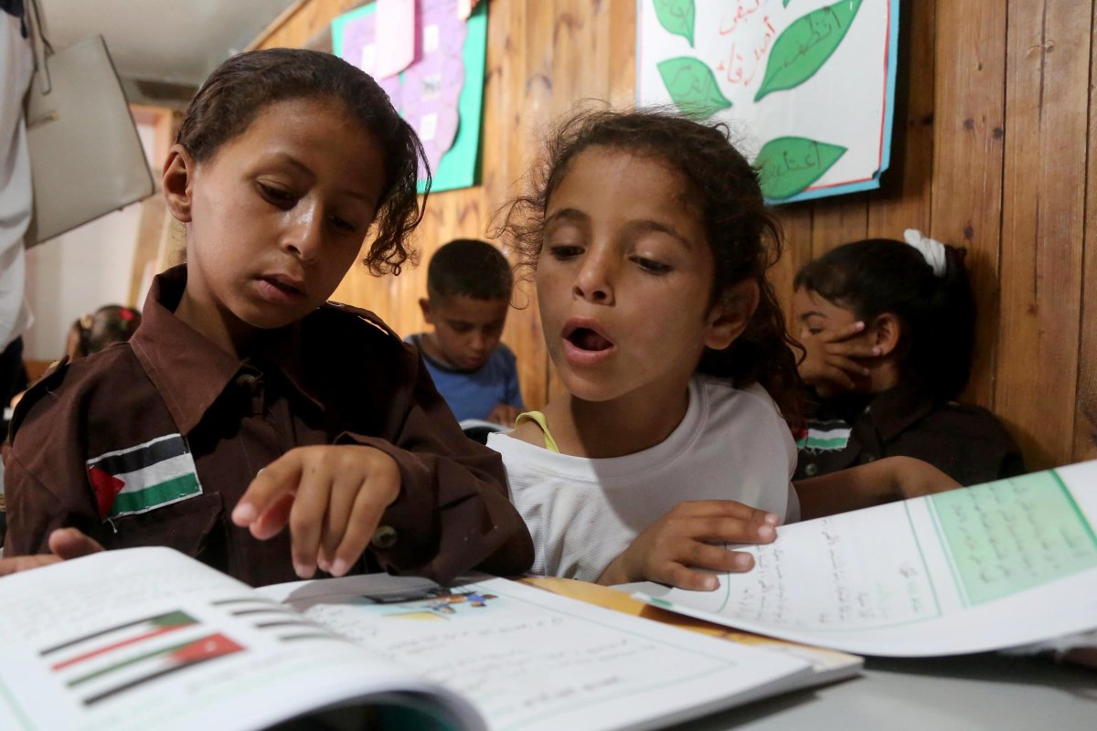 Palestinian bedouin children receive education in classroom at the only school in the region 'Itarat School' in Khan al-Ahmar region of Jerusalem on 16 July, 2018 [İssam Rimawi/Anadolu Agency]