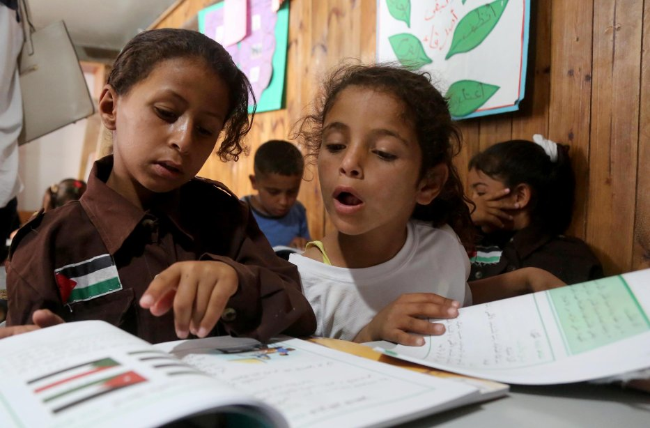 Palestinian bedouin children receive education in classroom at the only school in the region 'Itarat School' in Khan al-Ahmar region of Jerusalem on 16 July, 2018 [İssam Rimawi/Anadolu Agency]