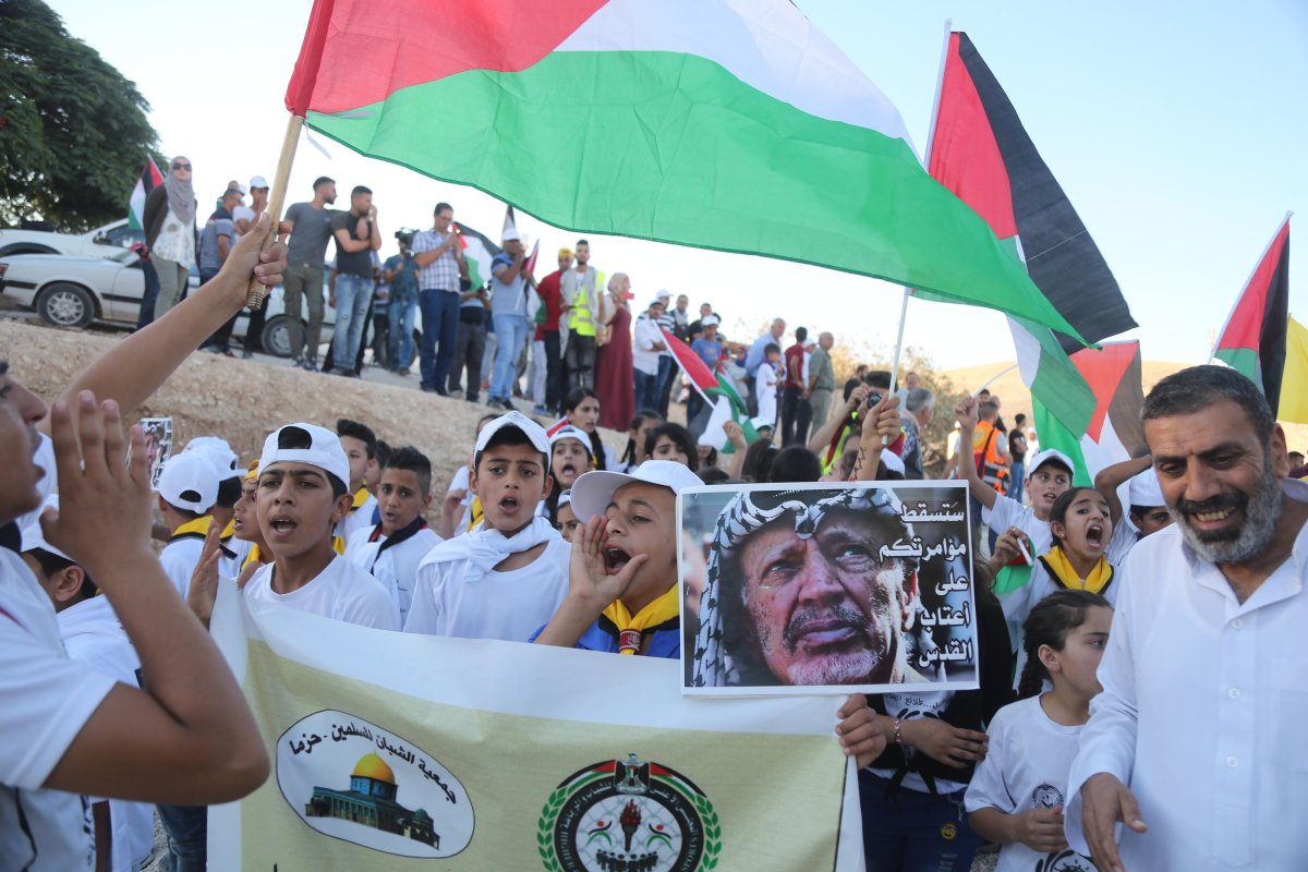 Palestinians stage a demonstration in support of Palestinian bedouins those who live in Khan al-Ahmar after Israeli authorities decided to destroy the houses of Palestinian bedouins in Khan al-Ahmar region of Jerusalem on 16 July, 2018 [Issam Rimawi/Anadolu Agency]