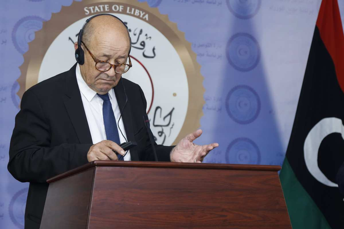 French Foreign Minister Jean-Yves Le Drian and Foreign minister of Libya Mohamed Taher Siala (not seen) hold a press conference after their meeting in the capital Tripoli, Libya on 23 July, 2018 [Hazem Turkia/Anadolu Agency]