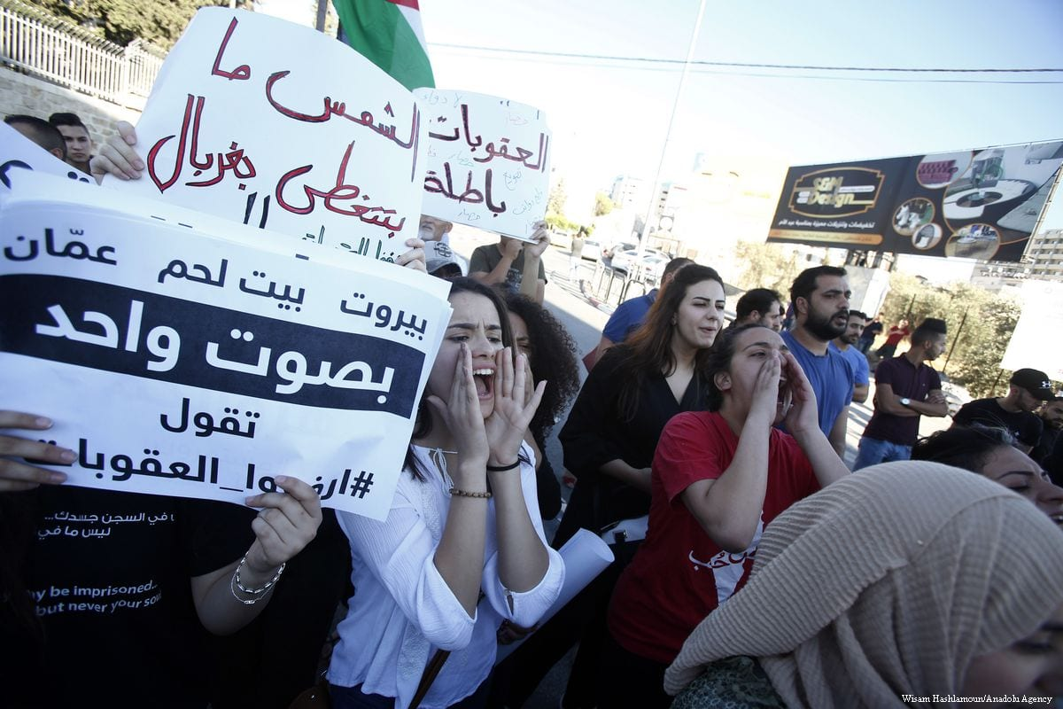 Protesters hold placards as they gather to protest in support of Gaza regarding on the segregation between Hamas and Fatah movements should be ended in Bethlehem, West Bank on 20 June 2018 [Wisam Hashlamoun/Anadolu Agency]