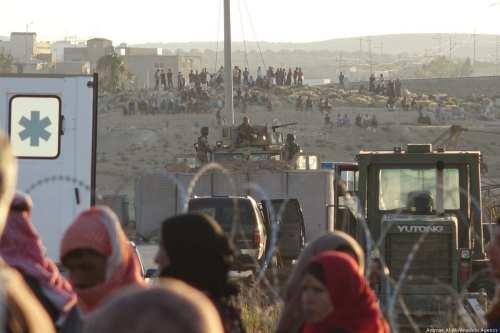 Syrians wait at the border areas near Jordan after they fled from Syria on 30 June 2018 [Ammar Al Ali/Anadolu Agency]