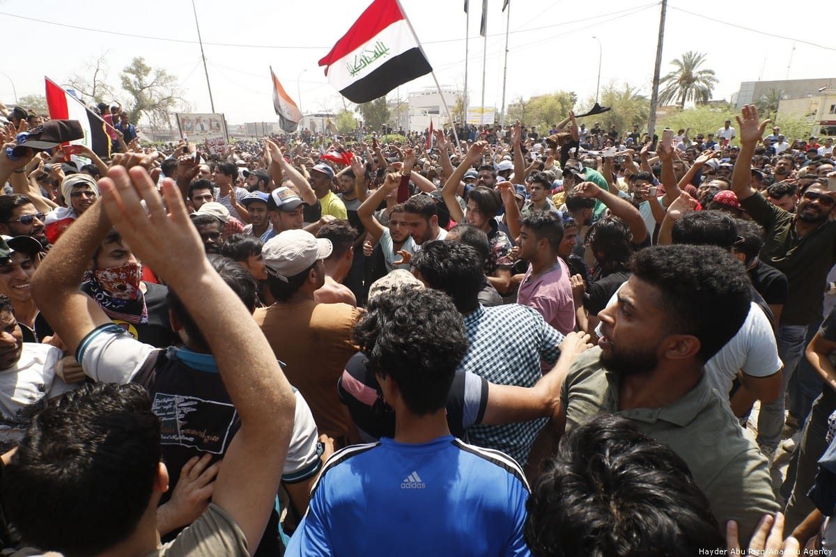 Iraqi citizens protest against the government in Basra on 15 July 2018 [Hayder Abu Rizq/Anadolu Agency]
