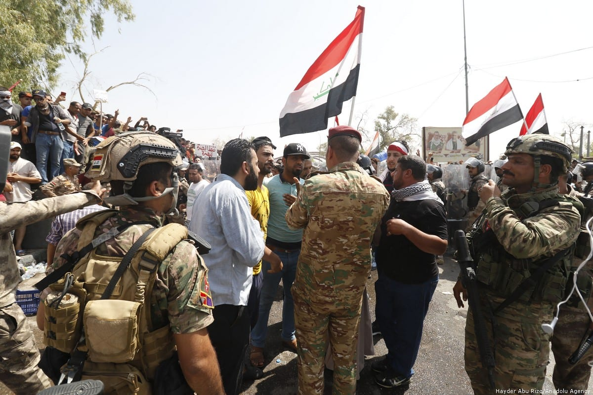 Iraqi citizens protest against the government on 15 July 2018 [Hayder Abu Rizq/Anadolu Agency]