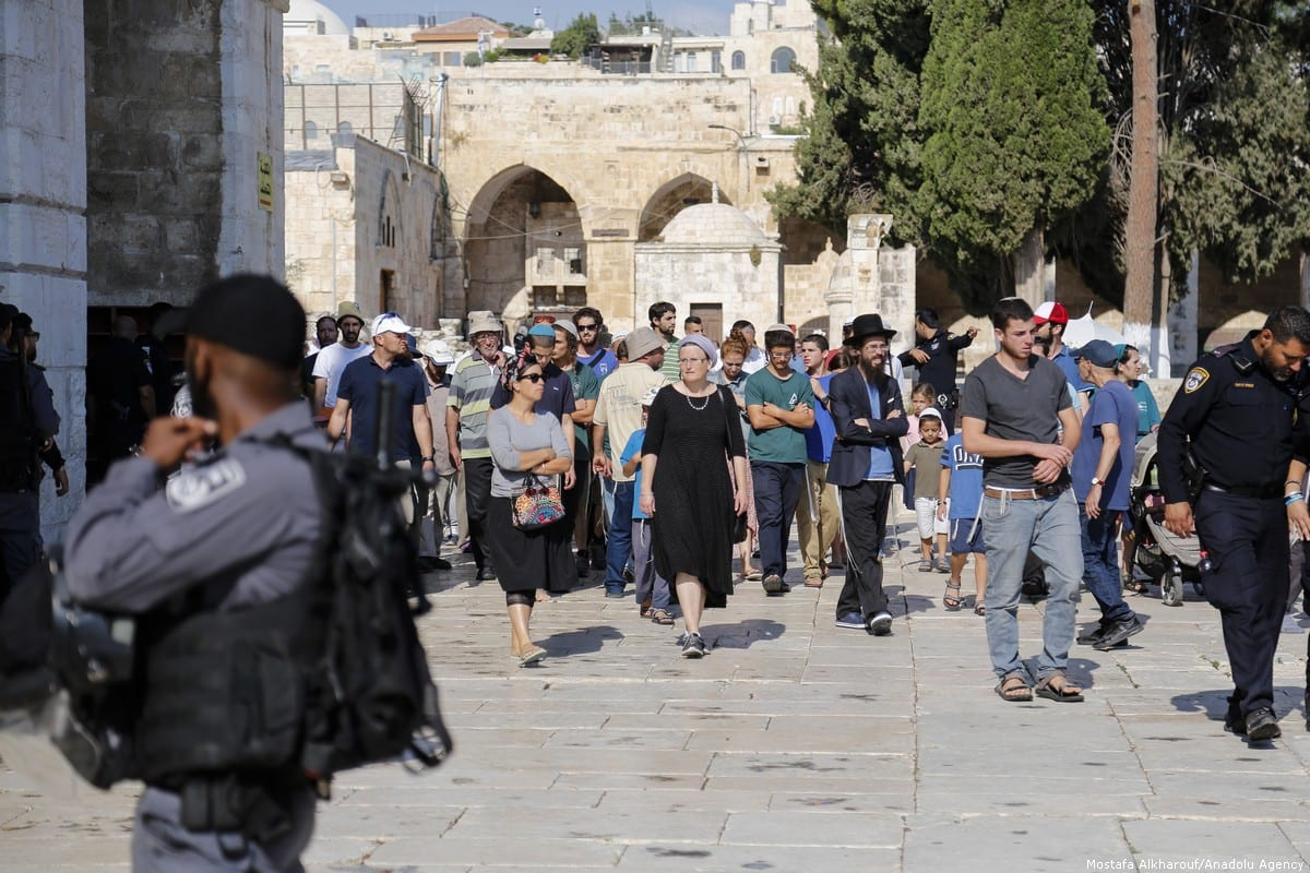 Israeli settlers can be sen after they stormed into Al-Aqsa Mosque compound in Jerusalem on 22 July 2018 [Mostafa Alkharouf/Anadolu Agency]