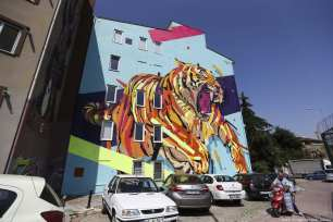 A view of a mural depicting a tiger drawn by Arlin, an artist from Brazil, on the facade of a building as part of the 7th Mural Istanbul Street Art Festival [Muhammed Enes Yıldırım/Anadolu Agency]
