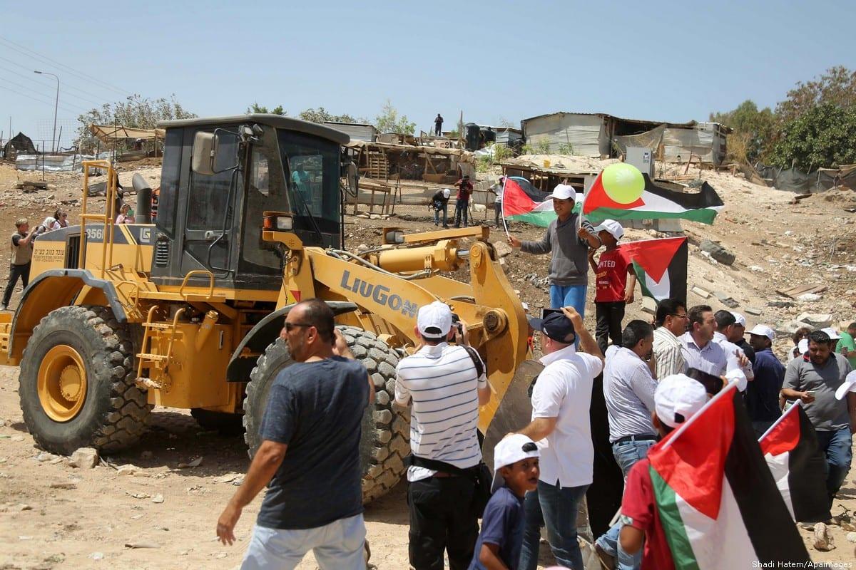 https://i0.wp.com/www.middleeastmonitor.com/wp-content/uploads/2018/07/2018_7-4-israeli-forces-and-protestors-in-Ahmar040718_SHH_00-4.jpg?resize=1200%2C800&quality=75&strip=all&ssl=1
