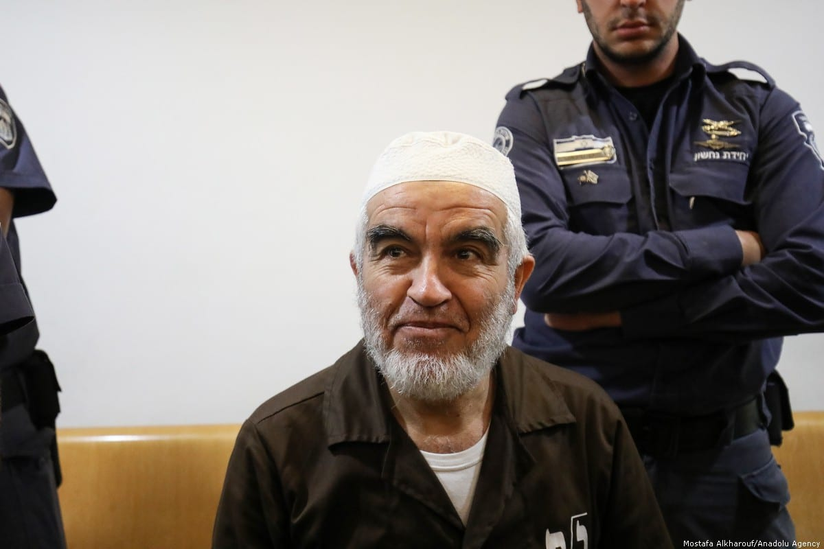 Leader of the Northern Branch of the Islamic Movement in Israel, Sheikh Raed Salah (C) appears in court in Haifa, Israel on 5 July 2018 [Mostafa Alkharouf/Anadolu Agency]