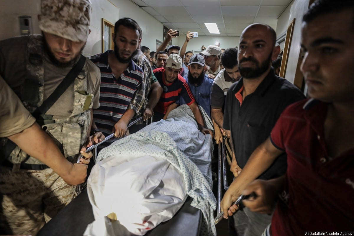 The body of a Palestinian who was killed after Israel carried out an air strike in Rafah, Gaza on 18 July 2018 [Ali Jadallah/Anadolu Agency]