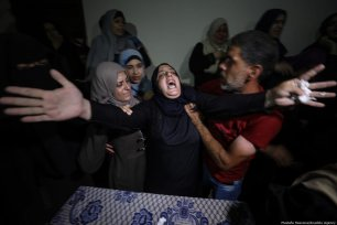 Relatives of Mahmoud Majed Al-Gharableh mourn for him after he died from the injures he received by Israeli soldiers during Great March of Return protest in Gaza City, Gaza on 5 July 2018 [Mustafa Hassona/Anadolu Agency]