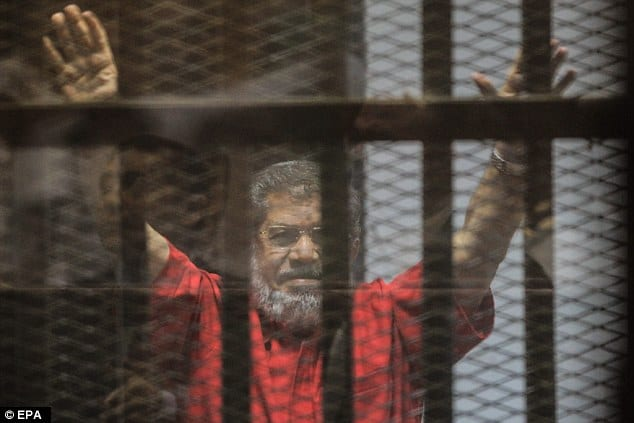 Egypt's ousted president Mohamed Morsi, wearing an orange uniform while in prison [Anadolu Agency/Facebook]