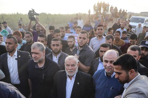 "Saleh al-Arouri (L2), deputy leader of Hamas and Ahmad Bahar (C), deputy head of the Palestinian Legislative Council take part in the 19th Friday of Palestine's ""Great Return March,"" on Gaza-Israeli border in Shuja'iyya neighborhood in Gaza City, Gaza on 3 August, 2018 [Mustafa Hassona/Anadolu Agency]"