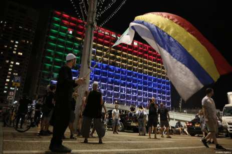 """Demonstrators from the Druze community hold flags as they stage a protest against the """"Jewish Nation-State"""" law that was approved last month by the Israel's parliament, at Rabin Square in Tel Aviv, Israel on August 04, 2018 [Daniel Bar On / Anadolu Agency]"""