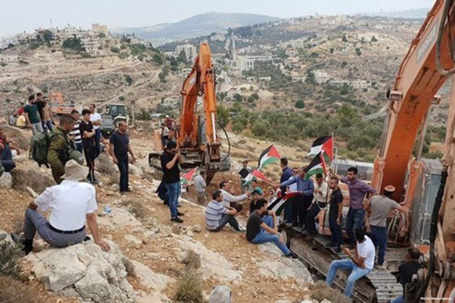 Israeli Jewish settlers raze private Palestinian lands in the village of Ras Karkar, West Bank [Ma'an News Agency]