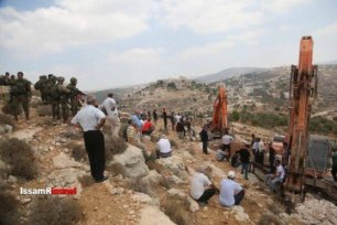 Israeli Jewish settlers raze private Palestinian lands in the village of Ras Karkar, West Bank [Issam al Rimawi]