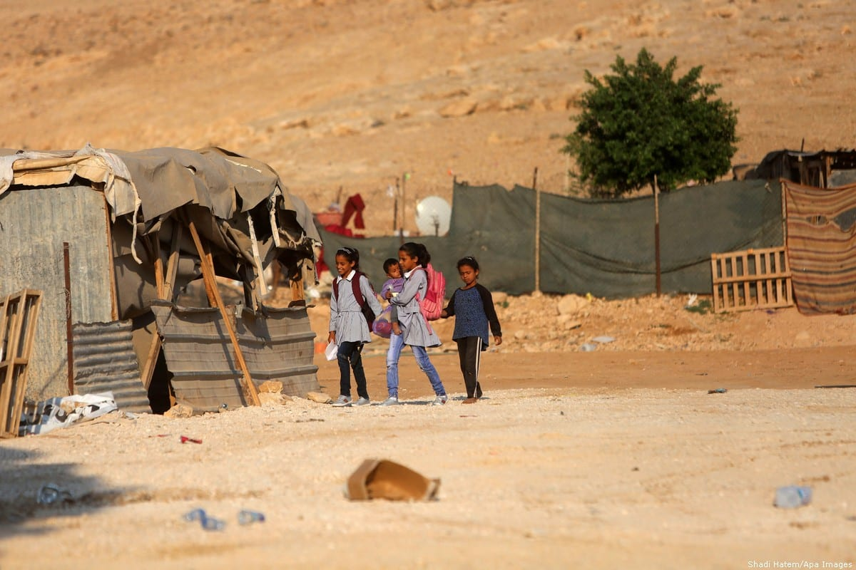 Palestinian schoolchildren and make shift tents can be seen at Bedouin village of Khan Al-Ahmar, east of Jerusalem in the occupied West Bank on 16 July 2018 [Shadi Hatem/Apa Images]