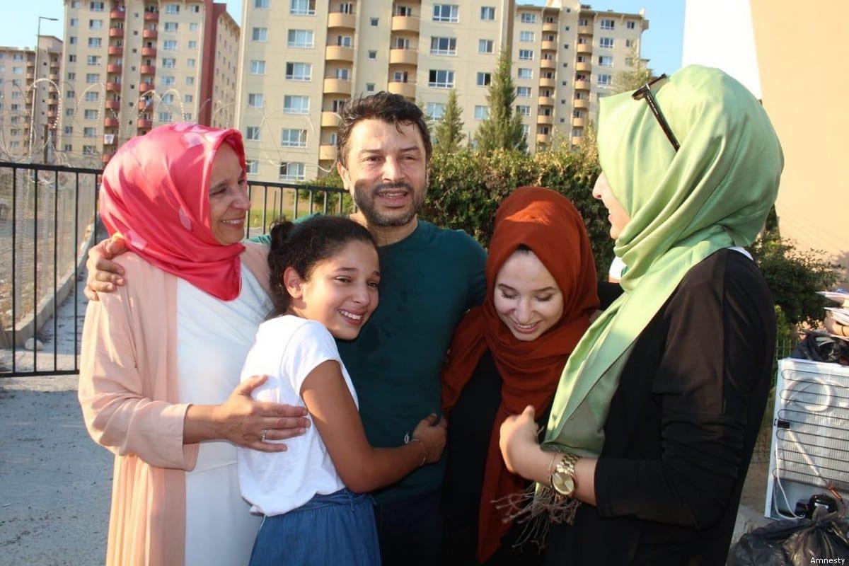 Chairman of Amnesty International in Turkey, Taner Kılıç with his family [Amnesty]