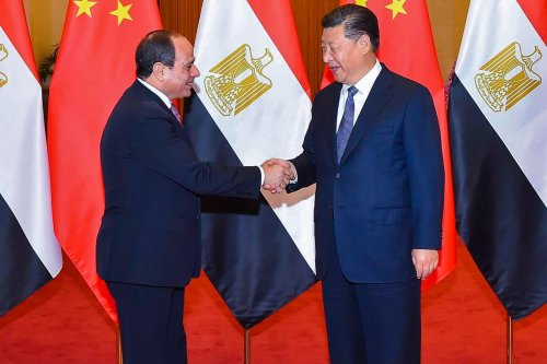 Egyptian President Abdel Fattah Al-Sisi (L) and Chinese President Xi Jinping (R) shake hands during their meeting at the Great Hall of the People in Beijing, China on 1 September, 2018 [Egyptian Presidency Handout/Anadolu Agency]