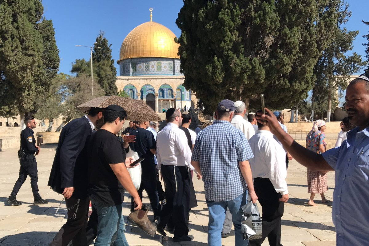 Israeli settlers storm the Al-Aqsa Mosque compound under the protection of Israeli occupation forces on 18 September 2018 [Jerusalem Islamic Waqf/handout]