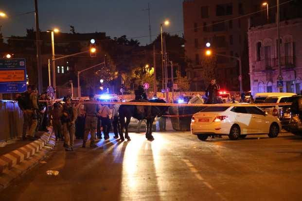 Israeli police cordon off a road after a Palestinian was shot dead near Damascus Gate in Old City in East Jerusalem on September 18, 2018. ( Mostafa Alkharouf - Anadolu Agency )