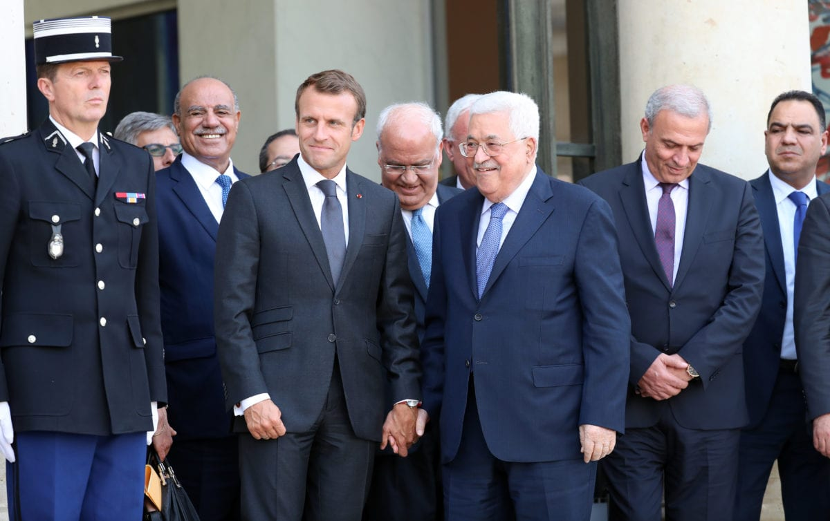 Palestinian President Mahmoud Abbas (2nd R) is escorted by French president Emmanuel Macron (2nd L) as he leaves at the Elysee Palace in Paris, France on 21 September, 2018 [Mustafa Yalçın/Anadolu Agency]