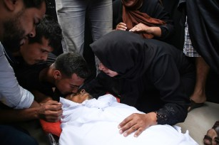 "Relatives of Muhammed Esref el-Avavide, who was killed by Israeli soldiers during ""Great March of Return"" demonstrations, mourn during his funeral ceremony at Al Bureij Refugee Camp in Gaza City, Gaza on September 29, 2018. ( Hassan Jedi - Anadolu Agency )"