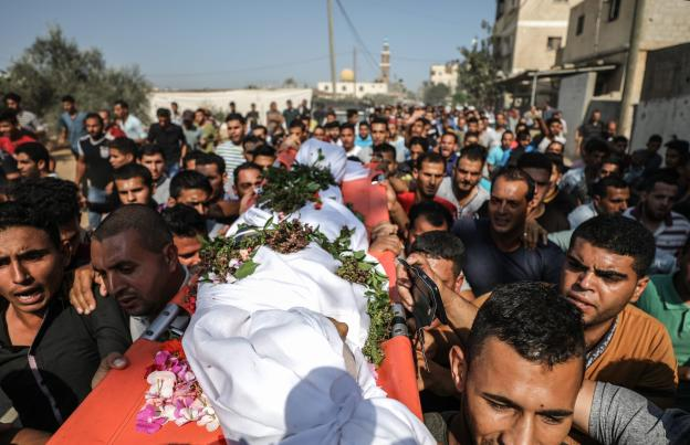 "Palestinians carry the dead body of Nasser Azmi Musbih (12), who was killed by Israeli soldiers during ""Great March of Return"" demonstrations, during his funeral ceremony in Khan Yunis, Gaza on 29 September, 2018 [Ali Jadallah/Anadolu Agency]"