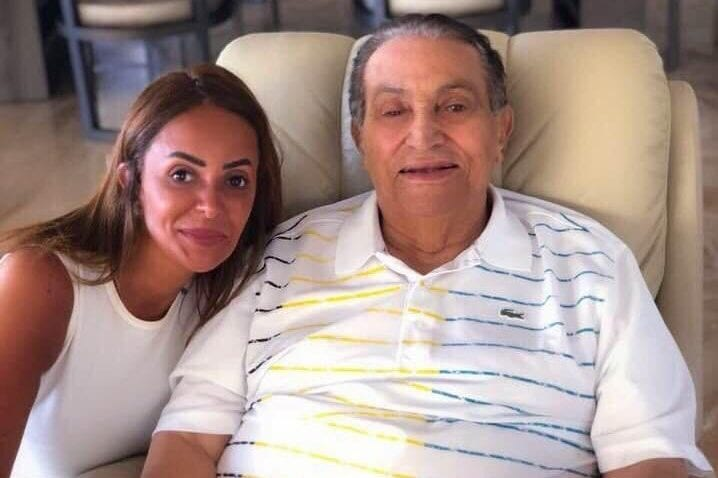 Former Egyptian President Hosni Mubarak, 90, seen sitting on a chair alongside Helly El-Saadani. The photo was released on social media on August 31, 2018 [Joyce_Karam / Twitter]