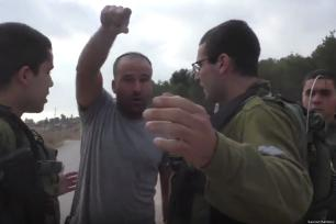 An Israeli settler has been filmed harassing Palestinian children as they made their way to school [Sawsan Bastawy]