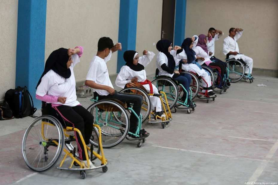 Palestinian wheelchairs users take part in a Karate lesson in Gaza City, Gaza [Ashraf Amra/Apaimages]