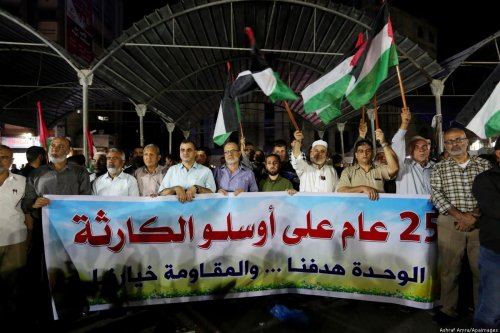 Palestinians take part in a protest on the occasion of the 25th anniversary of the Oslo accords, in Gaza on 16 September 2018 [Ashraf Amra/Apaimages]