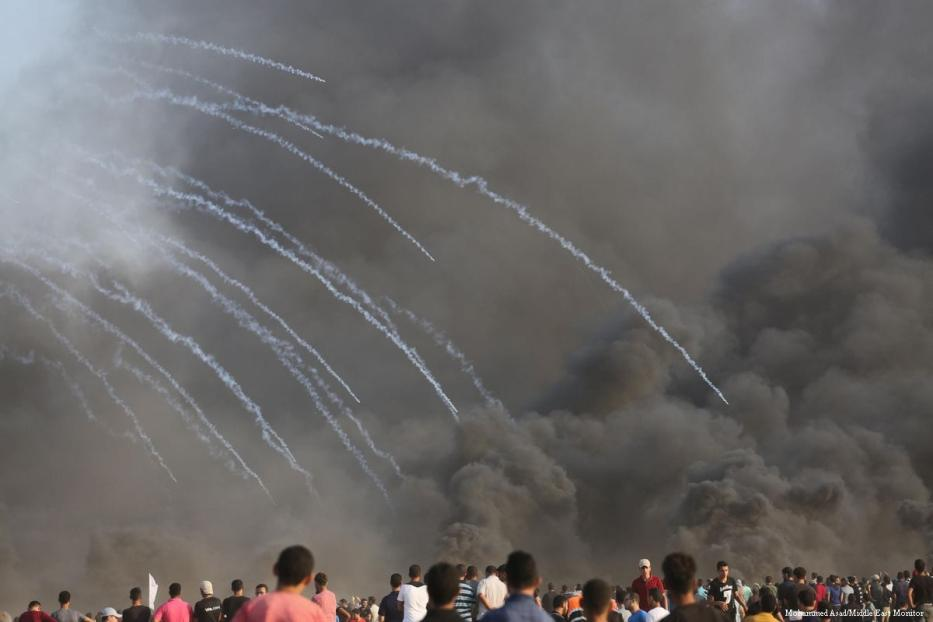 Israeli forces fire tear gas at Palestinians at the Israel and Gaza border [Mohammed Asad/Middle East Monitor]