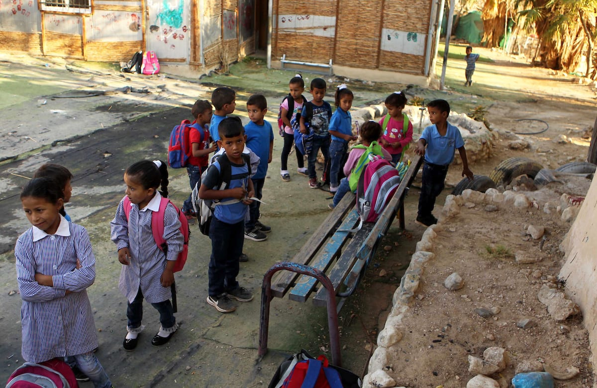 Palestinian Bedouin school children attend morning exercisesin a line at Khan al-Ahmar's school at Khan al-Ahmar's school in the village of Khan al-Ahmar in the Israeli occupied West Bank on 16 September, 2018 [Wisam Hashlamoun/Apaimages]