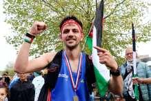 Sporting a Palestinian flag and a big medal, Mohammed celebrates his victory! Amsterdam, 21 October 2018 [Abdullah Aşıran/Anadolu Agency]
